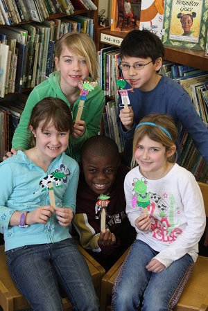 2nd Graders with Frog Puppets